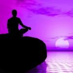 Man meditating at lake, water
